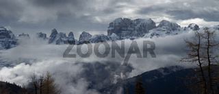 Snow-capped alps mountains in clouds