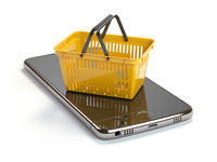 Mobile phone or smartphone with yellow shopping basket. Online shopping concept.