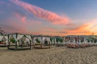 Chairs and umbrellas on a beautiful beach at sunrise in Sunny Beach on the Black Sea coast of Bulgaria