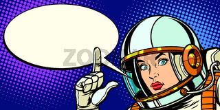 serious astronaut woman pointing up
