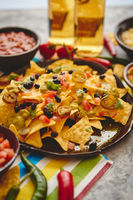 Mexican corn nacho spicy chips served with melted cheese