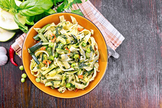 Tagliatelle with green vegetables on board top