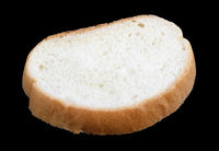 Flat piece of white wheat bread lie on table  isolated on black macro