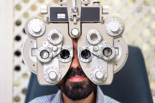 Patient in modern ophthalmology clinic checking the eye vision.