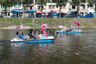 River Semois with people relaxing in pedalo in Bouillon, Belgium