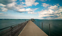 long exposure of the concrete pier in Altnau leading out into Lake Constance