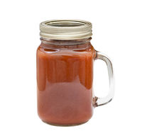 Homemade barbecue sauce in glass jar isolated on white background