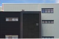 Modern industrial building with grilles