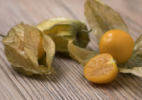 Physalis fruit (Physalis Peruviana) with husk on wooden background.
