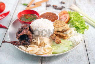 Nasi lemak kukus with quail meat