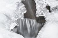 Ice formations beside a creek, Soeroeya Island, Finnmark, Norway