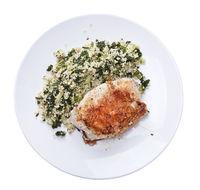 Chicken and quinoa salad on white background