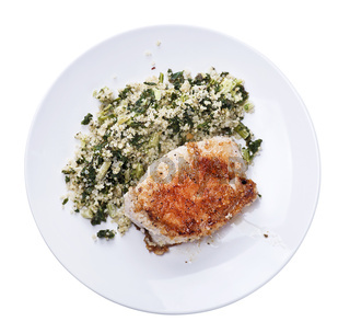 Chicken and quinoa salad on white background