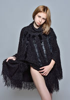 portrait of the beautiful woman in black coat