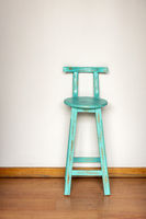 Blue Wooden Stool Against Wall