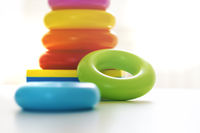 Colorful plastic rings on a white background to be stacked in a tower.