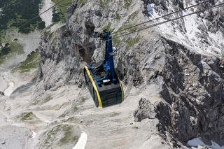 Top view cable car in Austrian Alps mountains