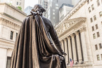 View from Federal Hall of the statue of George Washington and the Stock Exchange building in Wall Street, New York City.