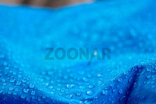 Nylon waterproof fabric with heavy blurred background and focused on the foreground water drops
