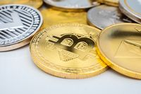 Bunch of Crypto currency coins with focus on BTC Bitcoin