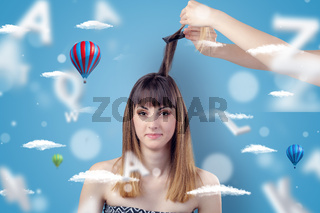 Young woman at hairdresser with air balloon theme