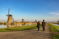 Rotterdam Netherlands, Love couple walking with Dutch Windmill at Kinderdijk Village