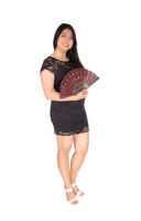Smiling Chinese woman in a black dress and holding a fan