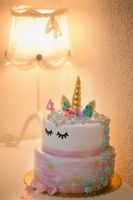 close-up view of delicious birthday cake with number four on top