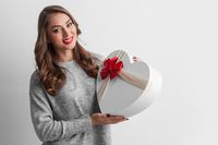 Woman holding heart shaped box