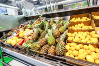 Fresh pineapples and other fruits ready for sale