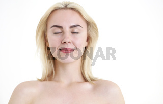 Young beautiful woman with blonde hair on white background
