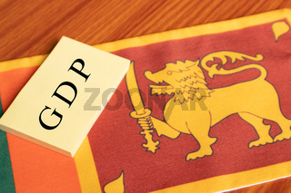 The word Gross Domestic Product or GDP written in Paper on Sri lanka Flag