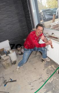 Disassembling an old finned tube heater
