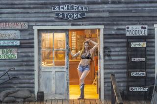 Lovely Brunette Cowgirl Model Posing Outdoors