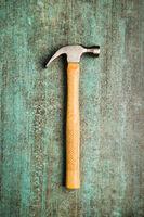 The claw hammer on grunge background.