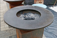 Round street cast-iron brazier for roasting fish meat and vegetables