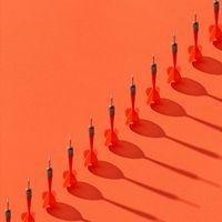 Diagonal line of darts with shadows.
