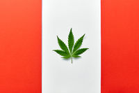 Altered Canadian flag with green cannabis leaf