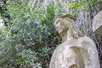 Jesus Christ cross, sculpture of jesus on the cross made in stone in the monastery of Montserrat in Barcelona, Spain