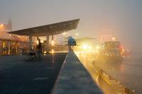 Hamburg, Germany - November 21, 2014: Foggy evening in November in Hamburg harbor. Long exposure.