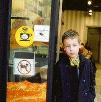 Schoolchild at the cafe doorway
