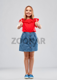 beautiful smiling girl showing thumbs up