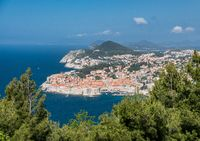 Fortress town of Dubrovnik in Croatia framed by trees