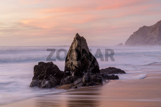 Coastal rock stack Sunset at Gray Whale Cove State Beach.