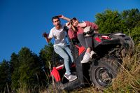 young couple driving a off road buggy car
