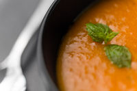 close up of vegetable pumpkin cream soup in bowl