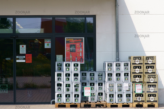 Beverage boxes in front of the shopping market