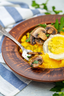 Delicious polenta with mushrooms and egg.