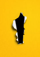 Yellow torn paper with black hole