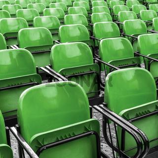 Empty plastic green chairs